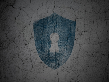 Privacy concept: Blue Shield With Keyhole on grunge textured concrete wall background, 3d render photo
