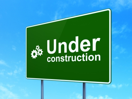 Web design concept: Under Construction and Gears icon on green road (highway) sign, clear blue sky background, 3d render photo