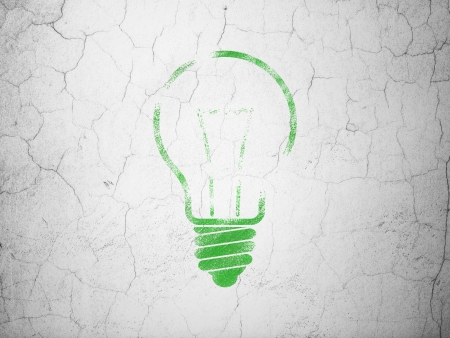 Finance concept: Green Light Bulb on textured concrete wall background, 3d render photo