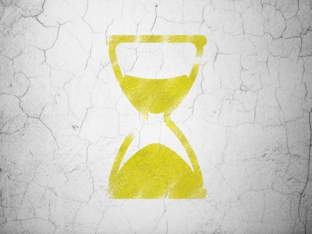Timeline concept: Yellow Hourglass on textured concrete wall background, 3d render photo