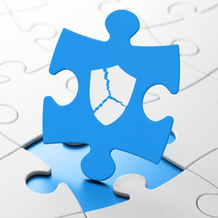 Safety concept: Broken Shield on Blue puzzle pieces background, 3d render photo