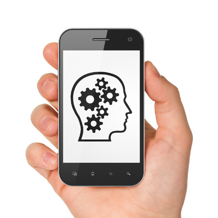 Finance concept: hand holding smartphone with Head With Gears on display. Mobile smart phone on White background, 3d render photo
