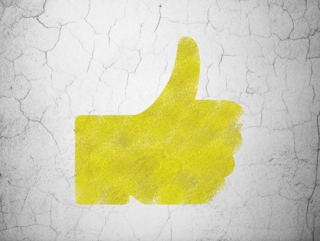 Social network concept: Yellow Thumb Up on textured concrete wall background, 3d render photo
