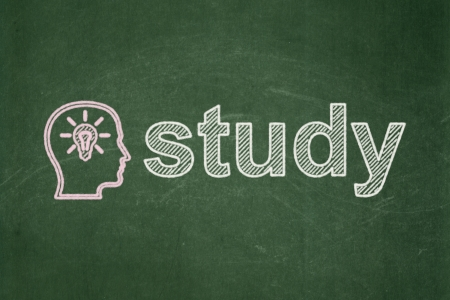 Education concept: Head With Lightbulb icon and text Study on Green chalkboard background, 3d render photo
