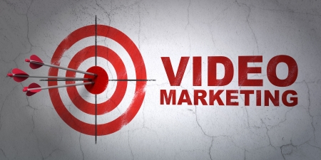 Success business concept: arrows hitting the center of target, Red Video Marketing on wall background, 3d render