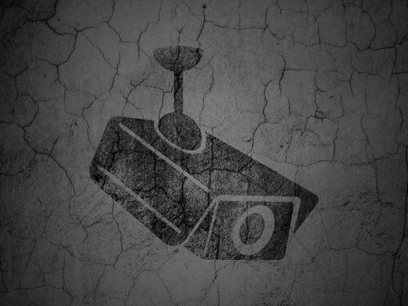 Protection concept: Black Cctv Camera on grunge textured concrete wall background, 3d render Stock Photo