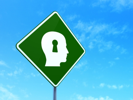 Data concept: Head With Keyhole on green road (highway) sign, clear blue sky background, 3d render photo