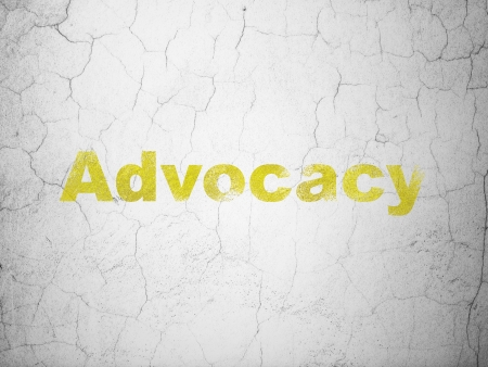 advocacy: Law concept: Yellow Advocacy on textured concrete wall background, 3d render