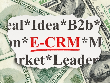 ecrm: Business concept: torn newspaper with words E-CRM on Money Stock Photo