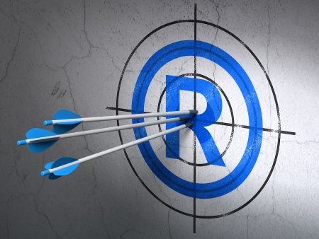 r regulation: Success law concept: arrows hitting the center of Blue Registered target on wall