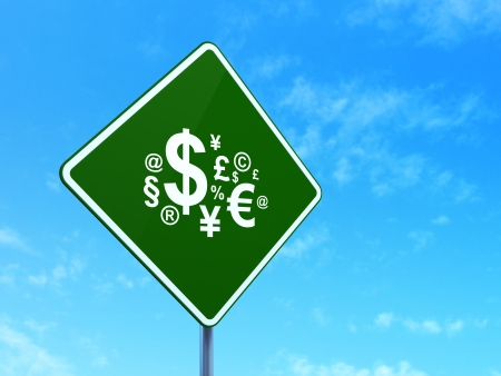 News concept: Finance Symbol on green road (highway) sign, clear blue sky photo