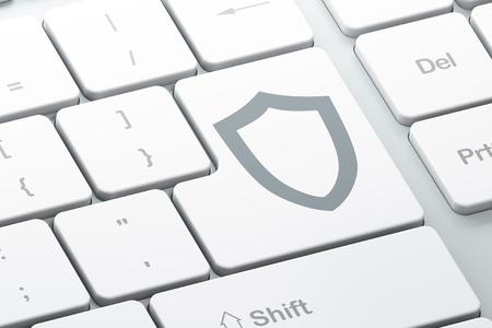 contoured: Concepto de seguridad: bot�n Enter con contorneada Shield en teclado de computadora Foto de archivo