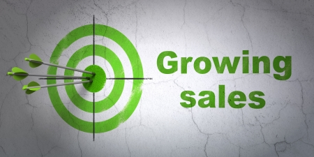 buisnes: Success finance concept: arrows hitting the center of target, Green Growing Sales on wall Stock Photo
