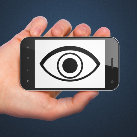Safety concept: hand holding smartphone with Eye on display. Mobile smart phone on Blue background, 3d render photo