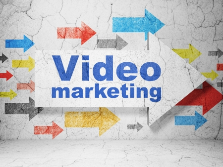 Business concept:  arrow with Video Marketing on grunge textured concrete wall background, 3d render
