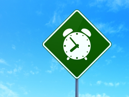 Time concept: Alarm Clock on green road (highway) sign, clear blue sky background, 3d render photo