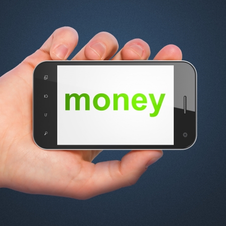 Finance concept: hand holding smartphone with word Money on display. Mobile smart phone on Blue background, 3d render photo
