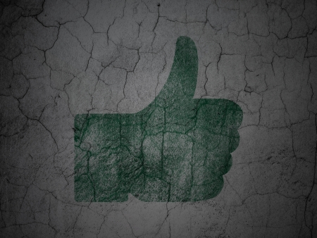 Social media concept: Green Thumb Up on grunge textured concrete wall background, 3d render photo