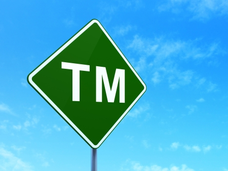 Law concept: Trademark on green road (highway) sign, clear blue sky , 3d render photo