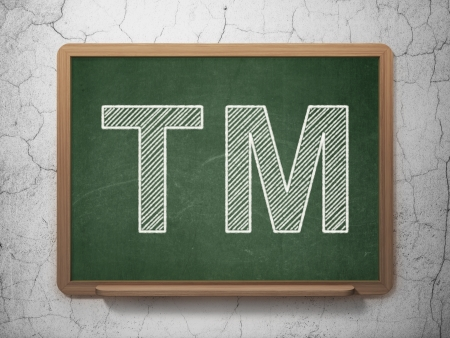 Law concept: Trademark icon on Green chalkboard on grunge wall background, 3d render photo