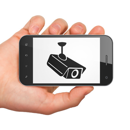Security concept: hand holding smartphone with Cctv Camera on display. Mobile smart phone on White background, 3d render photo