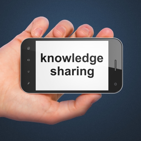 Education concept: hand holding smartphone with word Knowledge Sharing on display. Mobile smart phone on Blue background, 3d render photo