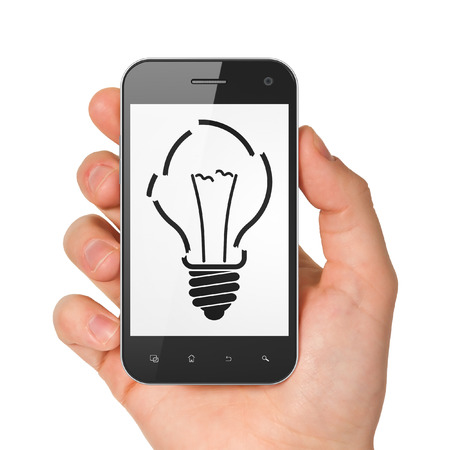 Business concept: hand holding smartphone with Light Bulb on display. Mobile smart phone on White background, 3d render photo