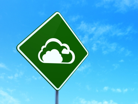 Cloud computing concept: Cloud on green road (highway) sign, clear blue sky background, 3d render photo