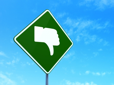 Social media concept: Thumb Down on green road (highway) sign, clear blue sky background, 3d render photo