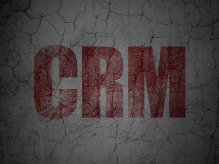 busines: Finance concept: Red CRM on grunge textured concrete wall background, 3d render