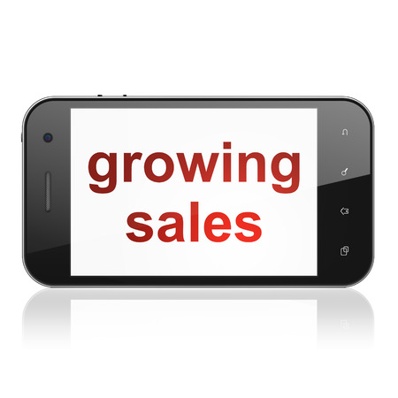 Business concept: smartphone with text Growing Sales on display. Mobile smart phone on White background, cell phone 3d render photo