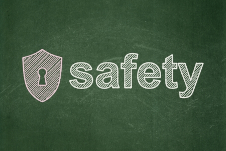 Privacy concept: Shield With Keyhole icon and text Safety on Green chalkboard background, 3d render photo