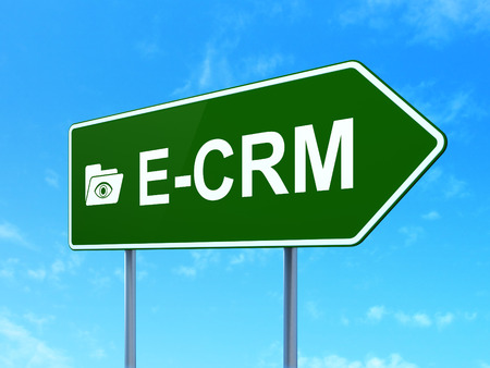ecrm: Business concept: E-CRM and Folder With Eye icon on green road (highway) sign, clear blue sky , 3d render Stock Photo