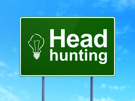 Business concept: Head Hunting and Light Bulb icon on green road (highway) sign, clear blue sky background, 3d render photo