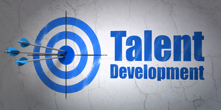 wall background: Success Education concept: arrows hitting the center of target, Blue Talent Development on wall background, 3d render