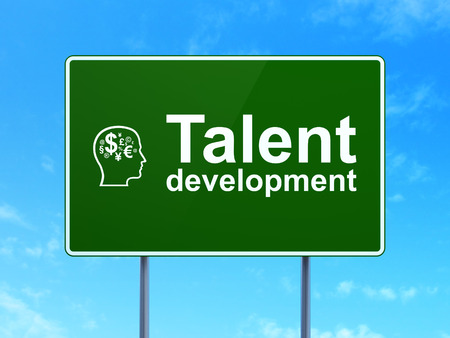 Education concept: Talent Development and Head With Finance Symbol icon on green road (highway) sign, clear blue sky background, 3d render photo
