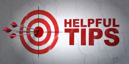 Success Education concept: arrows hitting the center of target, Red Helpful Tips on wall background, 3d render Stock Photo