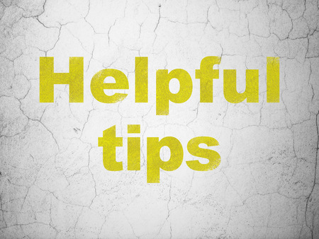 helpful: Education concept: Yellow Helpful Tips on textured concrete wall background, 3d render