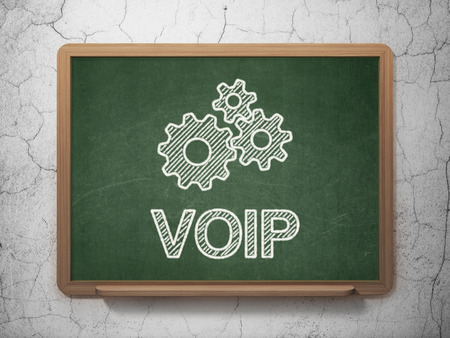 Web development concept: Gears icon and text VOIP on Green chalkboard on grunge wall background, 3d render photo
