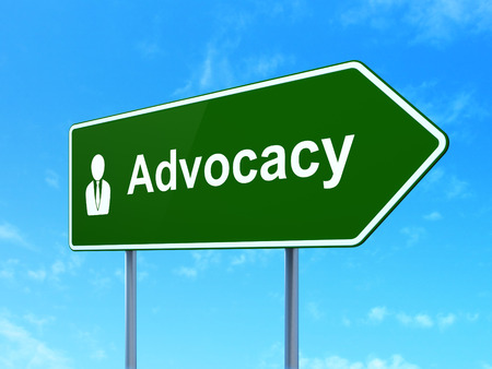 advocacy: Law concept: Advocacy and Business Man icon on green road (highway) sign, clear blue sky background, 3d render Stock Photo