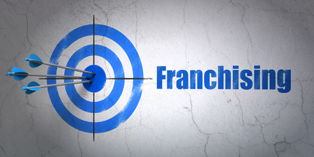 franchising: Success business concept: arrows hitting the center of target, Blue Franchising on wall background, 3d render Stock Photo