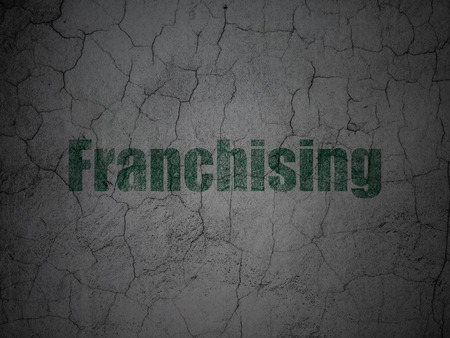 franchising: Finance concept: Green Franchising on grunge textured concrete wall background, 3d render Stock Photo