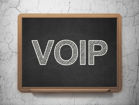 Web design concept: text VOIP on Black chalkboard on grunge wall background, 3d render photo