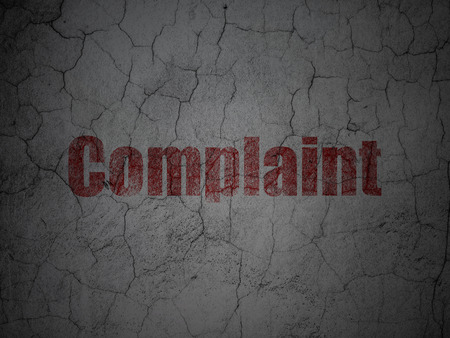 complaint: Red Complaint on grunge textured concrete wall background, 3d render
