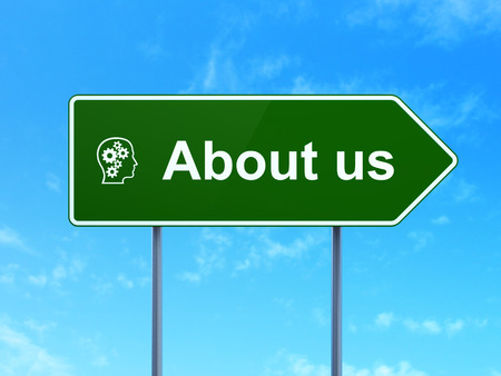 About Us and Head With Gears icon on green road (highway) sign, clear blue sky background photo