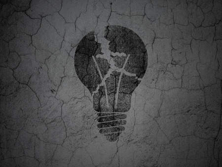 Business concept: Black Light Bulb on grunge textured concrete wall background photo