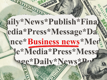 News concept: torn newspaper with words Business News on Money background photo