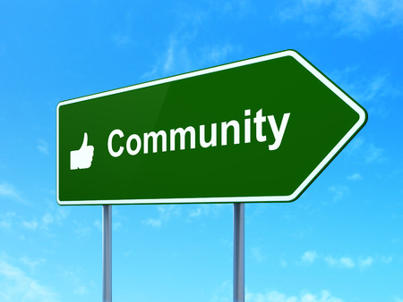Social network concept: Community and Thumb Up icon on green road (highway) sign, clear blue sky background, 3d render photo