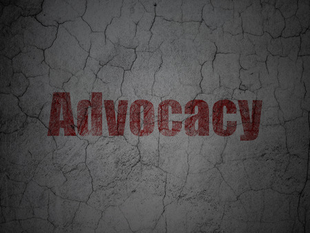 advocacy: Law concept: Red Advocacy on grunge textured concrete wall background, 3d render
