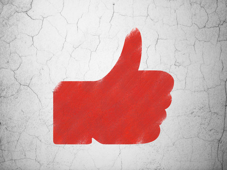 Social network concept: Red Thumb Up on textured concrete wall background, 3d render photo